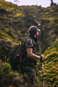 An image of a man climbing a mountain